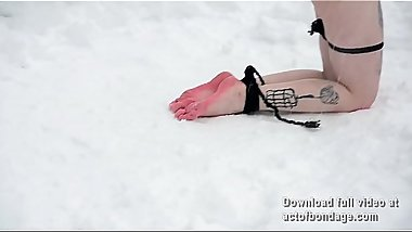 Naked and barefoot Vika tied up in the snow. Part 2