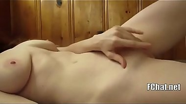 Sexy naked redhead babe masturbating on bed