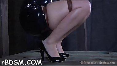 Bounded slave beauty is getting a lusty slit punishment