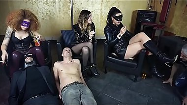 Three slaves are used as ashtrays by three ruthless mistresses