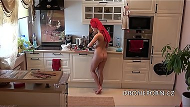 Naked and preparing food in the kitchen