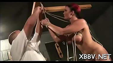 Naked wife stands fastened up and endures heavy breast thraldom