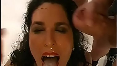 Lovely babe'_s mouth is filed with jizz during blow group-sex