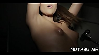 Voluptuous solo gal stuffs her twat with something hard