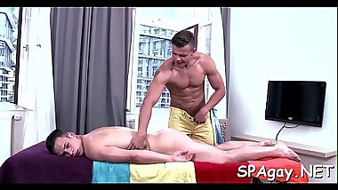 Hot white hunk is enjoying a lusty massage from darksome man
