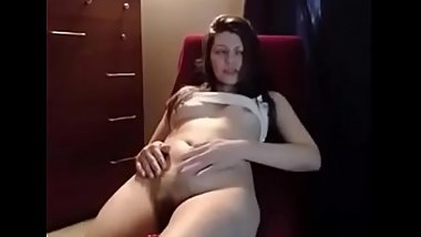 Sexy brunette with vibrator in natural bush puts on show