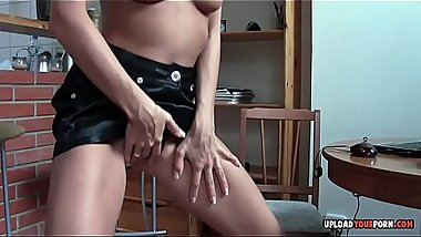 Solo brunette does a striptease before masturbating